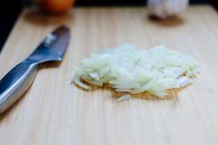Fresh chopped onion. On the wooden cutting board Stock Image