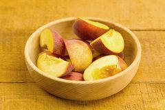 Fresh chopped peaches in a bowl on wooden background Stock Photo