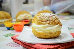 Fresh choux cream pastry on white dish Royalty Free Stock Photos