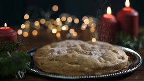 Fresh Christmas cake cooked to celebrate the New Year and Christmas, stands on a decorated table with Christmas tree stock footage