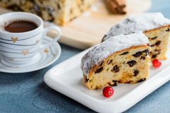 Fresh christmas stollen with raisins and a cup of coffee. Royalty Free Stock Photo