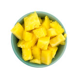 Fresh chunks of pineapple in a bowl. Top view of a bowl filled with freshly cut pineapple isolated on a white background Stock Image