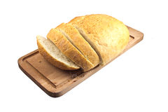 Fresh ciabatta bread sliced on a wooden plate Stock Photography