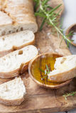 Fresh ciabatta with olive oil and rosemary. Italian bread. Royalty Free Stock Photography