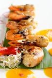 Fresh cilantro marinated Black Tiger shrimps Stock Photo