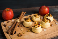 Fresh cinnamon buns with apples Royalty Free Stock Images
