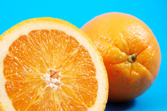 Fresh citrus. Bright and juicy oranges on a blue background stock photos