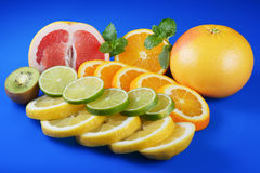 Fresh citrus  on blue background Royalty Free Stock Photos