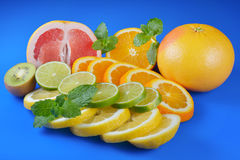 Fresh citrus  on blue background Royalty Free Stock Image