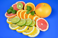 Fresh citrus  on blue background Royalty Free Stock Images