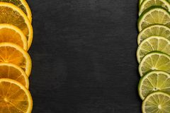 Fresh citrus fruit slices on dark border background with copy space, top view.  stock photography