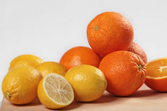 Fresh citrus fruits. On white bacground royalty free stock images