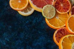 Fresh citrus fruits background Stock Images