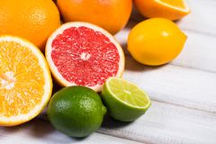 Fresh citrus fruits on a brown wooden table.  Stock Image