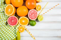 Fresh citrus fruits on a brown wooden table.  Royalty Free Stock Photography