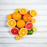 Fresh citrus fruits on a brown wooden table.  Royalty Free Stock Images
