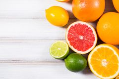 Fresh citrus fruits on a brown wooden table.  Stock Photography