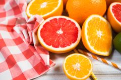 Fresh citrus fruits on a brown wooden table.  royalty free stock photos