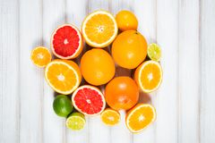 Fresh citrus fruits on a brown wooden table.  stock images