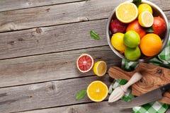 Fresh citrus fruits in colander Stock Image