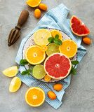 Fresh citrus fruits. On a concrete background royalty free stock images