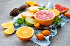 Fresh citrus fruits. On a concrete background stock images