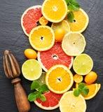 Fresh citrus fruits. On a black stone background stock photo