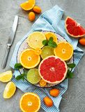 Fresh citrus fruits. On a concrete background stock photography