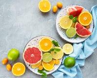 Fresh citrus fruits. On a concrete background stock photos