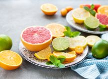 Fresh citrus fruits. On a concrete background royalty free stock photography