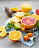 Fresh citrus fruits. On a concrete background royalty free stock image