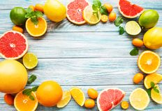Fresh citrus fruits. On a old wooden background royalty free stock photo
