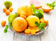 Fresh citrus fruits. On a old wooden background stock image
