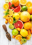 Fresh citrus fruits. On a old wooden background stock photos