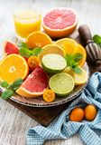 Fresh citrus fruits. On a old wooden table stock images