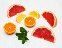 Fresh citrus fruits with green mint. On a old white wooden background Royalty Free Stock Photos