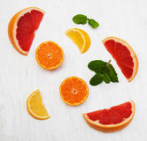 Fresh citrus fruits with green mint. On a old white wooden background Royalty Free Stock Image