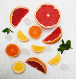 Fresh citrus fruits with ice and green mint Royalty Free Stock Image
