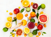 Fresh citrus fruits and juices royalty free stock photos