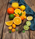 Fresh citrus fruits and old juicer Royalty Free Stock Images