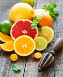 Fresh citrus fruits. On a old wooden background royalty free stock image