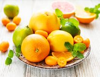 Fresh citrus fruits. On a old wooden background royalty free stock photography