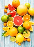 Fresh citrus fruits. On a old wooden background royalty free stock photos