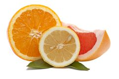 Fresh Citrus Fruits On A White. Stock Image