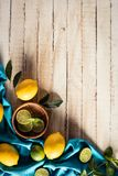Citrus fruits with tablecloth. Fresh citrus fruits with tablecloth on wooden tabletop with copy space Royalty Free Stock Image