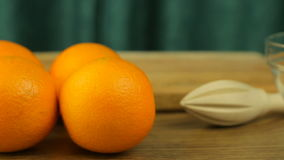 Fresh citrus fruits. Video footage concept of a healthy diet and diet. Oranges, a juicer, a knife, a bowl and a cutting board stock video footage