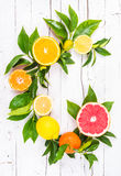 Fresh citrus fruits. On white wood background. Vitamin C fruits.Fruits letter.Still life fruits royalty free stock image
