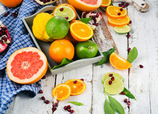 Fresh citrus fruits on a white wooden table. Stock Photography