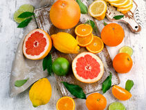 Fresh citrus fruits on a wooden table. Royalty Free Stock Image