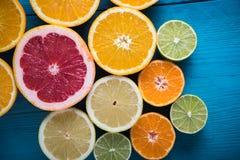 Fresh citrus half cut fruits overhead Royalty Free Stock Images
